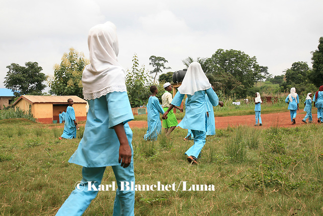 Girls coming back from the mosque and going back to the Islamic school in Sunyani, Ghana. In Ghana, coranic schools were transformed into islamic schools. Pupils learn the mainstream curriculum and have additional courses in arabic and islam.
