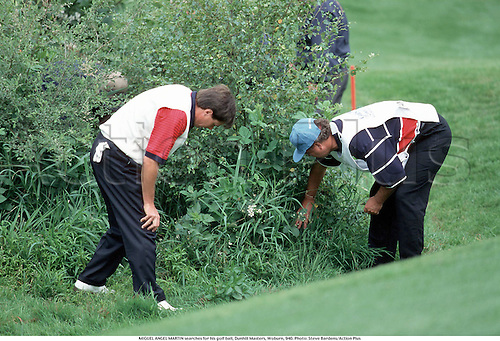 MIGUEL ANGEL MARTIN searches for his golf ball, Dunhill Masters, Woburn, 940. Photo: Steve Bardens/Action Plus...1994.golfer golfers