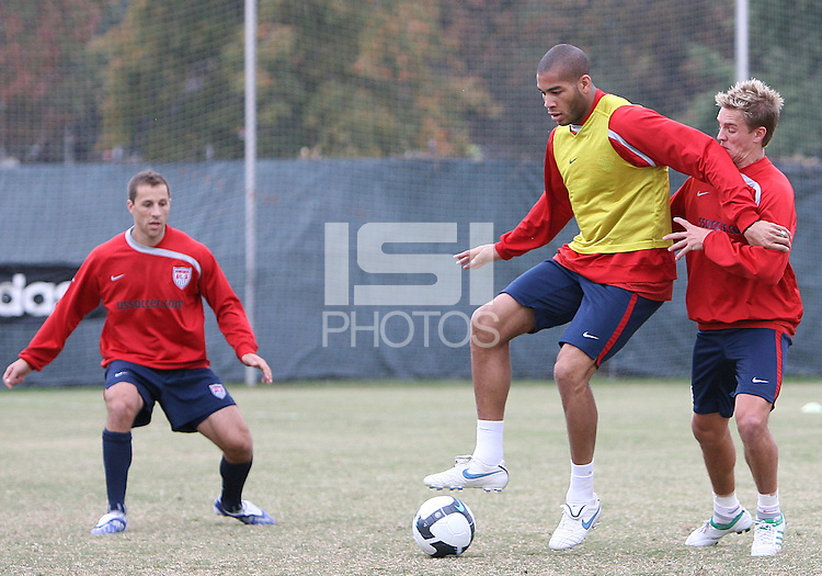Steve Cherundol watches Stuart Holden battle with Oguchi Onyewu of USA men's national team during a practice session before the final CONCACAF 2010 World Cup qualifying match at RFK practice facility, on October12 2009, in Washington D.C.