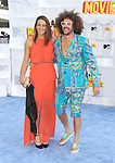 LOS ANGELES, CA - APRIL 12: Recording artist Redfoo (R) and guest arrive at the 2015 MTV Movie Awards at Nokia Theatre L.A. Live on April 12, 2015 in Los Angeles, California.