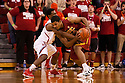 December 3, 2012: Eric Wise (34) of the USC Trojans is trying to keep the ball way from Benny Parker (3) of the Nebraska Cornhuskers during the first half at the Devaney Sports Center in Lincoln, Nebraska. Nebraska defeated USC 63 to 51.