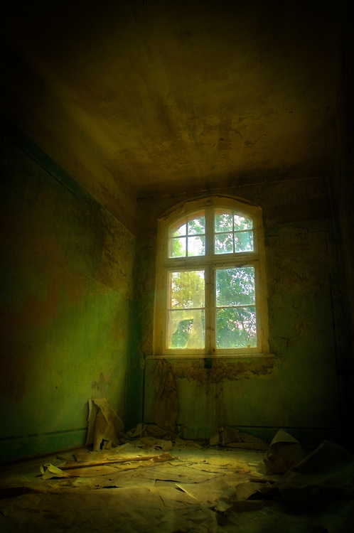 Light shining through window in old hospital