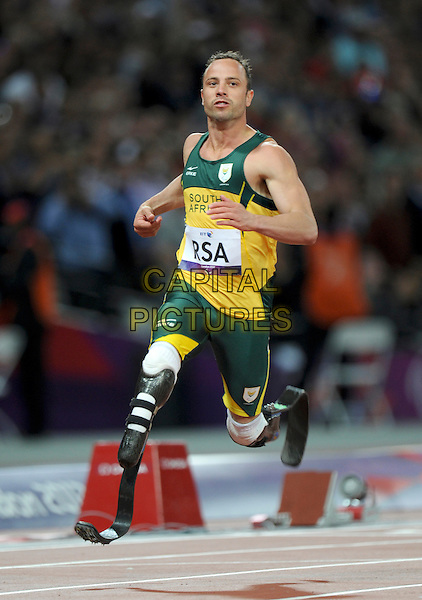 South African Paralympic athlete Oscar Pistorius has been charged with murder after his girlfriend Reeva Steenkamp was shot dead at his home in Pretoria .FILE PHOTO - London - 4x100m Relay Paralympics, London, England..September 5th 2012.full length  green yellow sport athlete runner sprinter amputee run running.CAP/PP/GM.©Gary Mitchell/PP/Capital Pictures.