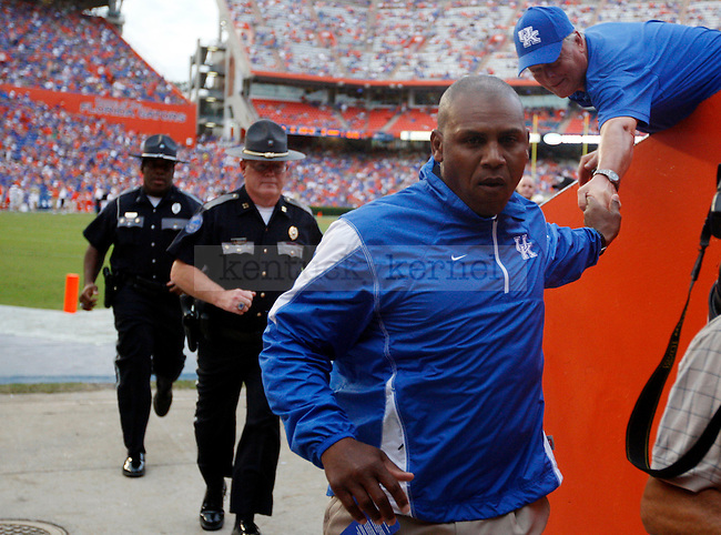 "UK head coach Joker Phillips high fives a fan before the first half of the UK vs Florida football game at the ""Swamp"" on Saturday, Sept. 25, 2010 Photo by Britney McIntosh 