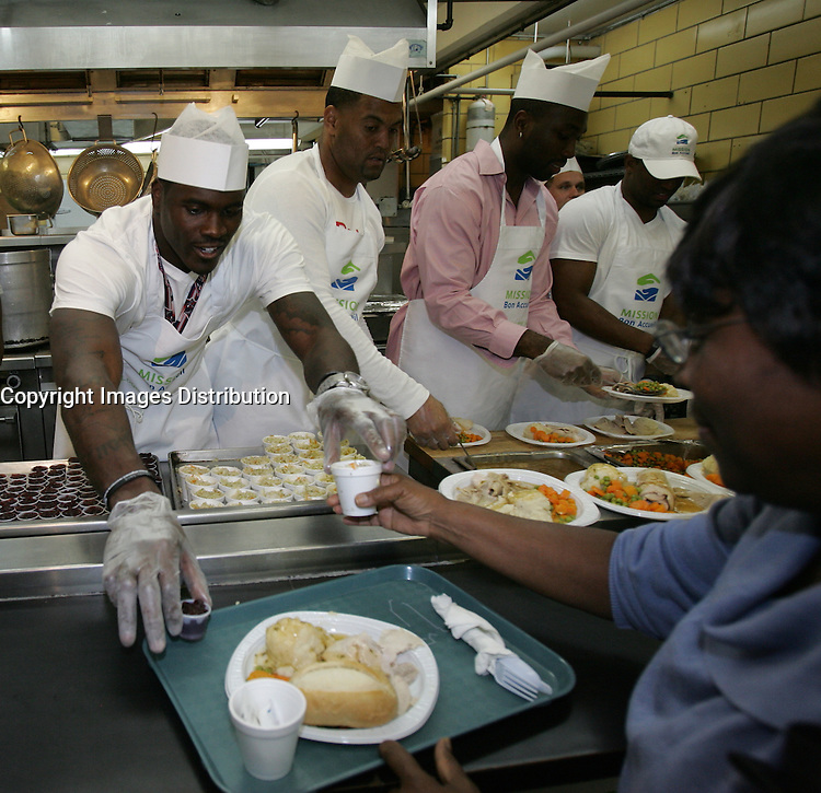 Montreal (Qc) CANADA -  October 2011 File Photo  - Montreal's Alouette (football) players serve food on Thanksgiving day