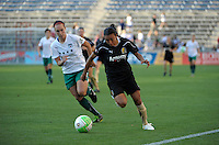 FC Gold Pride forward Marta (10) speeds away from Red Stars defender Whitney Engen (9).  The FC Gold Pride defeated the Chicago Red Stars 3-2 at Toyota Park in Bridgeview, IL on August 22, 2010