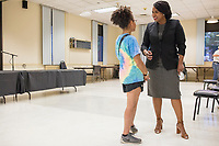 """College student Katherine Cabral (left), 20, of Chelsea, Mass., speaks with Ayanna Pressley after Pressley spoke at an event put on by Chelsea Black Community at the Chelsea Senior Center in Chelsea, Massachusetts, USA, on Wed., June 27, 2018. Pressley is running in the Democratic primary Massachusetts 7th Congressional District against incumbent Mike Capuano. Pressley is currently serving as a member of the Boston City Council, and is the first woman of color elected to the Council. Cabral is a volunteer for Pressley's campaign and says she will soon be canvassing for the candidate. """"I realized as a youth, I have a power to make a change,"""" Cabral said."""