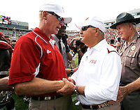 TALLAHASSEE, FL 10/31/09-FSU-NCST FB09 CH55-Florida State Head Coach Bobby Bowden, right, talks with N.C. State Head Coach Tom O'Brien at midfield after the Seminoles beat the Wolf Pack 45-42, Saturday at Doak Campbell Stadium in Tallahassee. .COLIN HACKLEY PHOTO