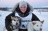First place winner Conway Seavey poses at the finish line with his lead dogs Sarge (R) at the finish line of the 2014 Jr. Iditarod Sled Dog Race at Happy Trails Kennel, Big Lake, Alaska<br /> Sunday February 23, 2014 <br /> <br /> Junior Iditarod Sled Dog Race 2014<br /> PHOTO BY JEFF SCHULTZ/IDITARODPHOTOS.COM  USE ONLY WITH PERMISSION
