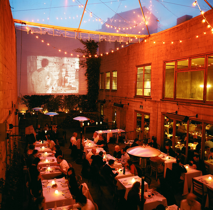 The Foreign Cinema in the Mission District, shows films projected on the wall of its outdoor patio where the audio is made available through vintage drive-in theater speakers next to the dining tables.