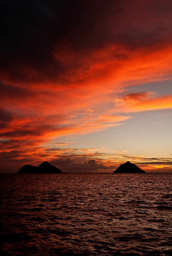 Fire in the Sky by Liisa Roberts.  Vivid sunrise capture on Lanikai Beach in Hawaii.