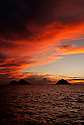 Fire in the Sky by Liisa Roberts.  Vivid sunrise capture on Lanikai Beach in Hawaii.