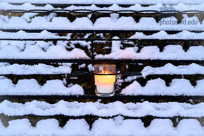 February 13, 2020; Grotto candle in snow (Photo by Matt Cashore/University of Notre Dame)