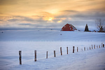 Idaho, Central, McCall. A winter farm scene in evening light.
