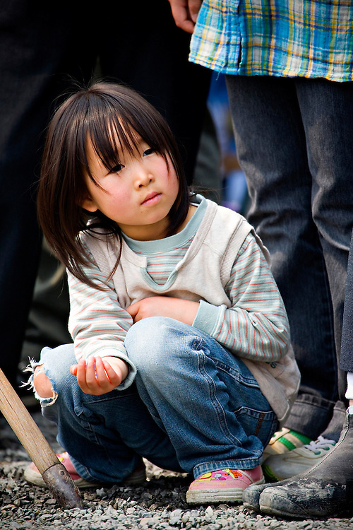 A young girl holds onto a small bouncing ball at the Sekku Matsuri