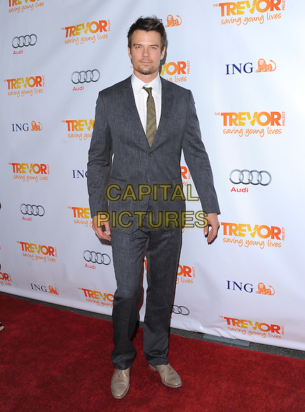 Josh Duhamel.Trevor Live at The Hollywood Palladium in Hollywood, California, USA..December 4th, 2011  .full length suit  grey gray shirt white facial hair  .CAP/RKE/DVS.©DVS/RockinExposures/Capital Pictures.