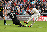 Saturday, 20 October 2012<br /> Pictured: Pablo Hernandez of Swansea (R) scoring the opening goal, Gary Caldwell of Wigan fails to stop him.<br /> Re: Barclays Premier League, Swansea City FC v Wigan Athletic at the Liberty Stadium, south Wales.
