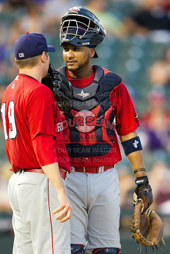 Oklahoma City RedHawks PPP Carlos Corporan #22 talks with teammate Brian Bass #19 during the Pacific Coast League baseball game against the Round Rock Express on June 15, 2012 at the Dell Diamond in Round Rock, Texas. The Express shutout the RedHawks 2-1. (Andrew Woolley/Four Seam Images).