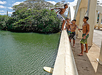 These local kids asked me to photograph them jumping off the Anahula Bridge in Haleiwa Town. They checked under the bridge for swimmers and paddleboarders before each jump, but didn't see the girl here in this photo (neither did I).