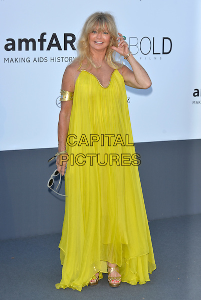 Goldie Hawn.amfAR 20th Cinema Against Aids Gala at the Hotel du Cap, Antibes, during the 66th Cannes Film Festival, France 23rd May 2013..full length yellow dress voluminous maxi cuff arm band bracelet gold .CAP/PL.©Phil Loftus/Capital Pictures.