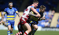 Warrington Wolves' Blake Austin is tackled by Wigan Warriors' Joe Greenwood <br /> <br /> Photographer Stephen White/CameraSport<br /> <br /> Rugby League - Coral Challenge Cup Sixth Round - Warrington Wolves v Wigan Warriors - Sunday 12th May 2019 - Halliwell Jones Stadium - Warrington<br /> <br /> World Copyright © 2019 CameraSport. All rights reserved. 43 Linden Ave. Countesthorpe. Leicester. England. LE8 5PG - Tel: +44 (0) 116 277 4147 - admin@camerasport.com - www.camerasport.com
