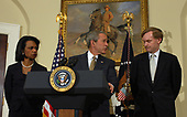 Washington, D.C. - May 8, 2006 -- United States President George W. Bush, backed by United States Secretary of State Condoleezza Rice and Deputy Secretary of State Robert Zoellick, discusses the situation in Darfur, Sudan, in the Roosevelt Room of the White House on May 8, 2006. Zoellick recently returned from Sudan where he helped put together a tenuous peace plan.  Bush said he was sending Rice to the United Nations on Tuesday to urge the Security Council to pass a resolution to seed the deployment of United Nations (U.N.) peacekeeping troops in Darfur to protect residents from further violence. He also said he had directed the acceleration of food and humanitarian assistance to Darfur and urged congress to approve an extra $225 million more in food aid as part of its emergency spending bill.<br /> Credit: Roger Wollenberg - Pool via CNP