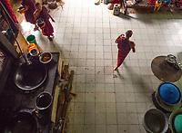 A Monastery in Sagaing, Mandalay, Myanmar Monks preparing the food