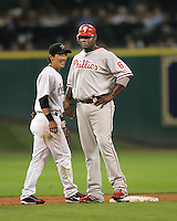 Astros 2B Kaz Matsui greets Phillies 1B Ryan Howard on Thursday May 22nd at Minute Maid Park in Houston, Texas. Photo by Andrew Woolley / Four Seam Images.