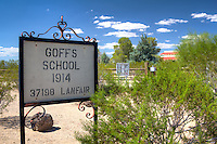 The first school in Goffs opened its doors for the fall term in 1911 serving the needs of cattle ranches, mining districts, homesteaders, the railroad, and, most of all, the people supporting expanding travel on the national old trails road - later U.S. highway 66. A new school, featuring a distinctive mission style, was designed by architect A. Beimer in 1914 and constructed by Tom Waer on land donated by H.F. Ware.<br /> <br /> The new school house was a source of pride for the community. It served their needs for  a community center as well as a school until the spring of 1937 after U.S. highway 66 was realigned and other factors had diminished the population. It reverted to private ownership in 1938 and became a private residence until 1954.  During World War II it was in the midst of a large desert training center army camp - their being more than 10,000 soldiers here at some times.  From 1954 to 1982 the building was abandoned. In 1982 Jim and Bertha Wold acquired the property and started restoration. In 1990 further restoration by the friends of the Mojave road began.