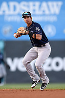 Second baseman Oswaldo Cabrera (10) of the Charleston RiverDogs throws out a runner in a game against the Greenville Drive on Friday, April 27, 2018, at Fluor Field at the West End in Greenville, South Carolina. Greenville won, 5-4. (Tom Priddy/Four Seam Images)