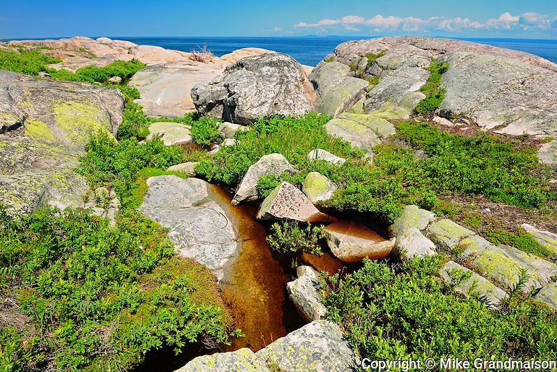 Rocky coastline on Gulf of St.Lawrence<br /> Cap-de-Bon-Désir<br /> Quebec<br /> Canada