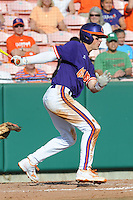 Second Baseman Steve Wilkerson #17 swings at a pitch during a  game against the Miami Hurricanes at Doug Kingsmore Stadium on March 31, 2012 in Clemson, South Carolina. The Tigers won the game 3-1. (Tony Farlow/Four Seam Images)..