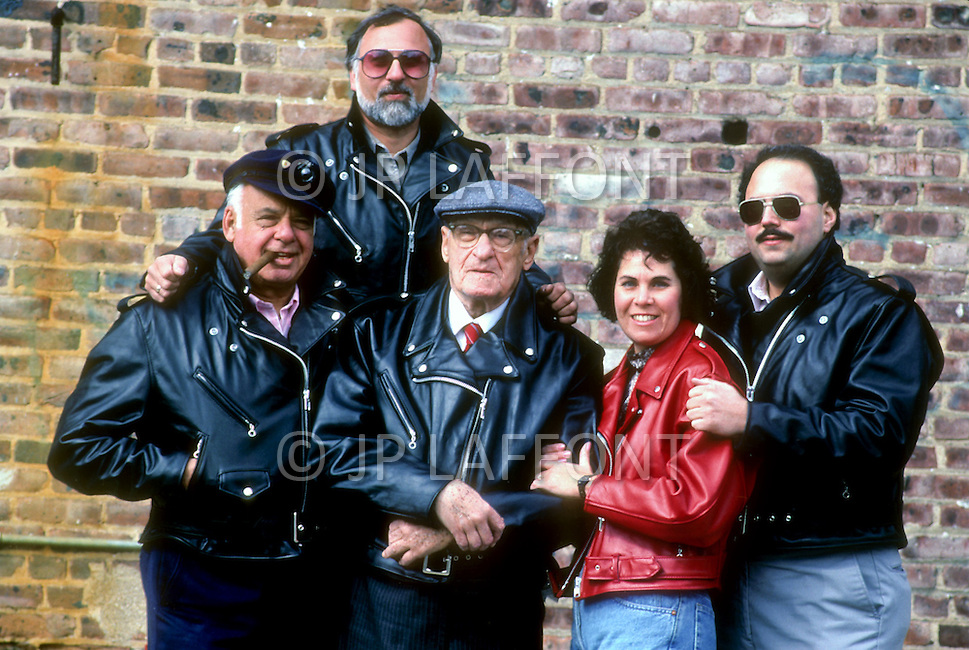 "Perth Amboy, New Jersey, U.S.A, February, 1989. The Schott family, in the center Irving Schott at the age of 98, on the right with the cigar is Melvin the actual President of the ""Perfecto"" factory where the famous leather jackets are made. Bomber pilots and Harley-Davidson buffs adopted them, as did James Dean and Elvis Presley. The Perfecto has become a myth."