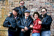 """Perth Amboy, New Jersey, U.S.A, February, 1989. The Schott family, in the center Irving Schott at the age of 98, on the right with the cigar is Melvin the actual President of the """"Perfecto"""" factory where the famous leather jackets are made. Bomber pilots and Harley-Davidson buffs adopted them, as did James Dean and Elvis Presley. The Perfecto has become a myth."""