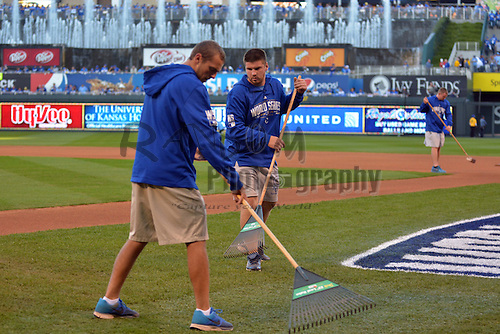 Oct 21, 2014; Kansas City, MO, USA; Kansas City Royals grounds crew members prepare the field before game one of the 2014 World Series against the San Francisco Giants at Kauffman Stadium. Mandatory Credit: Denny Medley-USA TODAY Sports