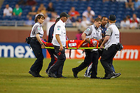 7 June 2011: Medical staff carry Panama defender Luis Henríquez (17) off the pitch during the CONCACAF soccer match between Panama and Guadeloupe at Ford Field Detroit, Michigan.