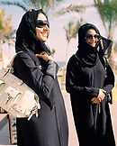 OMAN, Barr Al Jissa Resort and Spa, Muslim women in traditional clothing, smiling