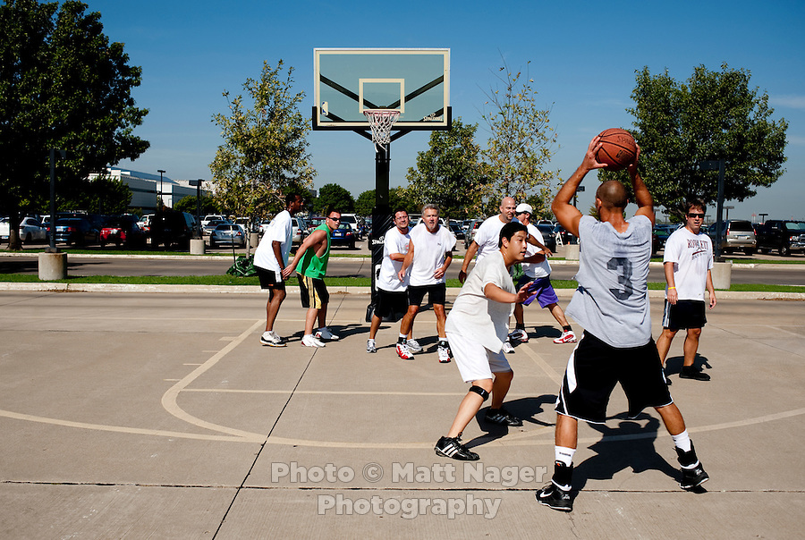 Southwest Airlines employees play basketball during lunch break at Southwest Airlines headquarters at Love Field Airport in Dallas, Texas, Wednesday, October 27, 2010...PHOTO/ MATT NAGER