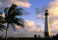 Cape Florida Lighthouse sits in the distance with Palm trees in the foreground, Cape Florida Light, Key Biscayne State Park, Dade County, Florida
