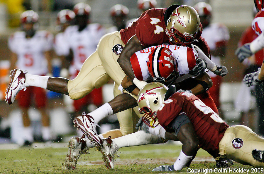 TALLAHASSEE, FL 9/12/09-FSU-JSUFB09 CH27-Florida State's Maurice Harris, left and Toshmon Stevens crunch Jacksonville State's Antonio Bonner during second half action Saturday at Doak Campbell Stadium in Tallahassee. .COLIN HACKLEY PHOTO