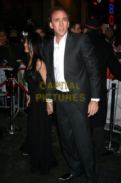 "ALICE KIM & NICOLAS CAGE .The World Premiere Of Columbia Pictures ""Ghost Rider"" at at Regal E-Walk Stadium 13, New York City, New York, USA..February 15th, 2007.Nicholas full length black dress married husband wife suit.CAP/IW.©Ian Wilson/Capital Pictures"