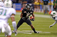 20 December 2011:  FIU wide receiver Wayne Times (5) carries the ball after a reception in the first quarter as the Marshall University Thundering Herd defeated the FIU Golden Panthers, 20-10, to win the Beef 'O'Brady's St. Petersburg Bowl at Tropicana Field in St. Petersburg, Florida.