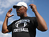 Dwight Singleton, Wyandanch athletic director and varsity football head coach, talks to his team before a Division IV game against Center Moriches at Wyandanch High School on Thursday, Sept. 7, 2017.