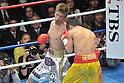 (L-R) Yota Sato (JPN), Suriyan Sor Rungvisai (THA),.MARCH 26, 2012 - Boxing :.Yota Sato of Japan hits Suriyan Sor Rungvisai of Thailand in the fourth round during the WBC super flyweight title bout at Korakuen Hall in Tokyo, Japan. (Photo by Hiroaki Yamaguchi/AFLO)