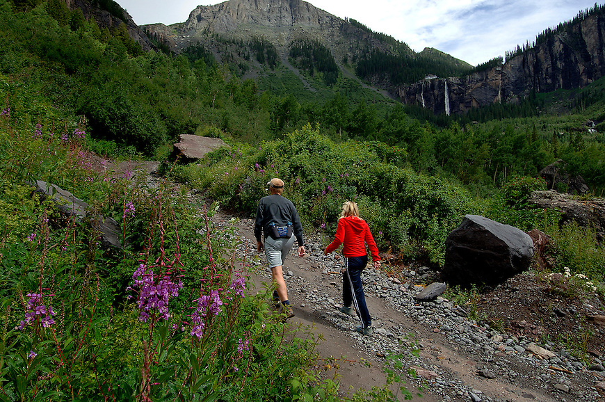 Mike and Terri Hunter, of Irving, TX hike a four wheel drive road to the base of Bridal Veil Falls on Saturday afternoon, just outside Telluride.© Michael Brands. 970-379-1885.