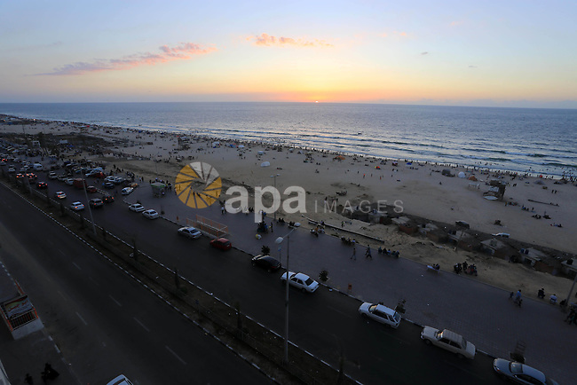 A general view of Gaza's beach showing Palestinians enjoy a day on Sep. 05, 2014. Photo by Mohammed Asad