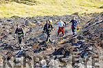 Members of the Kerry Fire Service attending the badly fire damaged sand dunes on Banna Beach that were burned on Saturday afternoon..