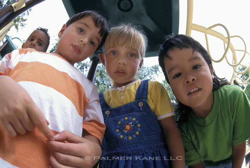 Fisheye lens portrait of a group of children at a playground