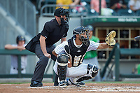 Charlotte Knights catcher Seby Zavala (5) sets a target as home plate umpire Rich Grassa looks on during the game against the Gwinnett Braves at BB&T BallPark on July 12, 2019 in Charlotte, North Carolina. The Stripers defeated the Knights 9-3. (Brian Westerholt/Four Seam Images)