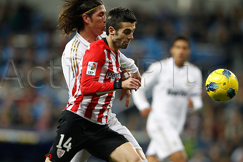 22.01.2012. Madrid Spain. La Liga  The match played between  Real Madrid and Athletic Club de Bilbao (4-1)  played at the Santiago Bernabeu Stadium.  Picture show Markel Susaeta Laskurain (Spanish midfielder of Athletic) and Sergio Ramos (Spanish defender of Real Madrid)